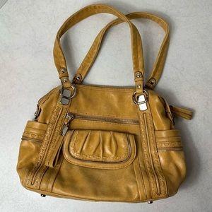 B. Makowsky yellow handbag